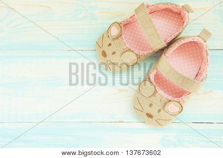 baby shoes on a blue rustic background