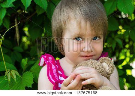 modest face of a little girl outdoors