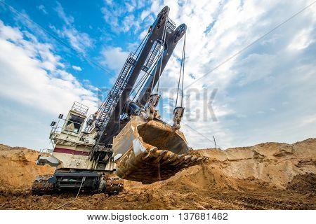 Big excavator in an open pit. Coal mining.