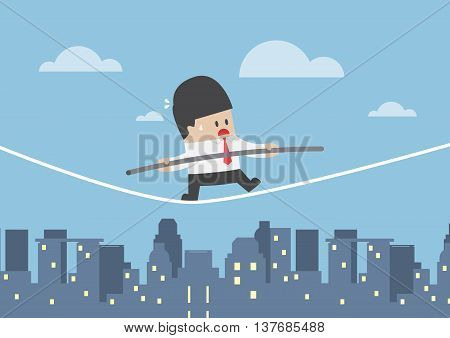 Businessman Walking On A Rope Over The City