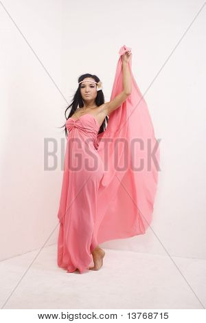 Brunette in  a pink long dress