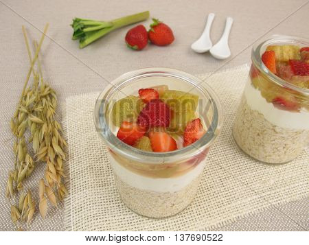 Overnight-Oats with quark, rhubarb and strawberries in jars