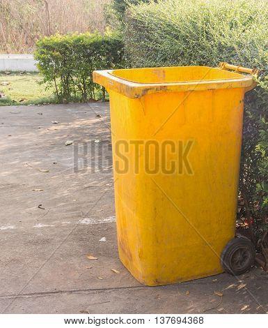 yellow dustbins trashcan rubbish bins in the garden.