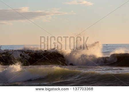 Wavy sea and cliff in Marina di Massa Italy