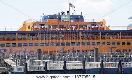 NEW YORK, NY - JUN 19: Staten Island Ferry returns to Manhattan, New York, as seen on Jun 19, 2016. The ferry carries over 21 million passengers a year.