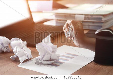 Concept no idea . Business woman maul paper on the desk.
