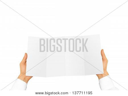 Hand in white shirt holding blank leaflet in the hand. Offset brochure presentation. Pamphlet hand man. Man show paper. Sheet template. Menu in hands. Booklet design. Fold paper sheet display.