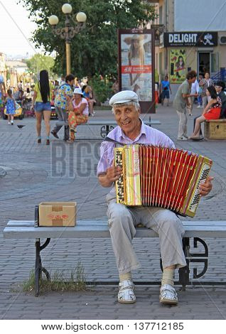 Man Is Playing Bayan Outdoor In Ulan Ude, Russia
