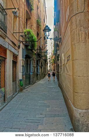 Tourists In The Tight Street Of Gothic Quarter In Barcelona