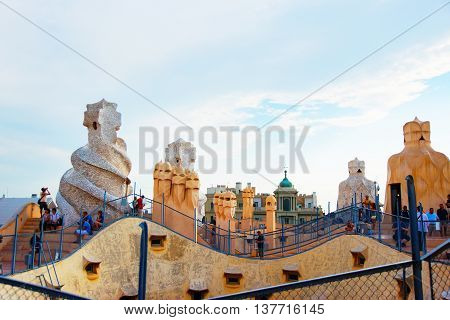 Tourists On Roof With Chimneys At Casa Mila Building