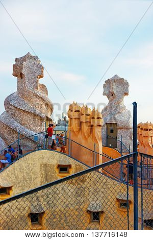 Tourists On The Roof With Chimneys At Casa Mila Building