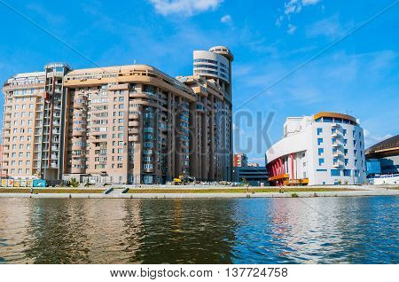 YEKATERINBURG RUSSIA -AUGUST 24 2013. Summer architecture urban view- residential modern buildings and Team Sports Palace near Iset river in Yekaterinburg. Architecture summer landscape