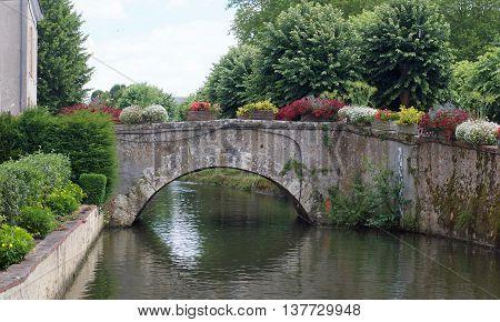 urban landscape with a bridge and vegetation in Bonneval, Eure et Loire, France