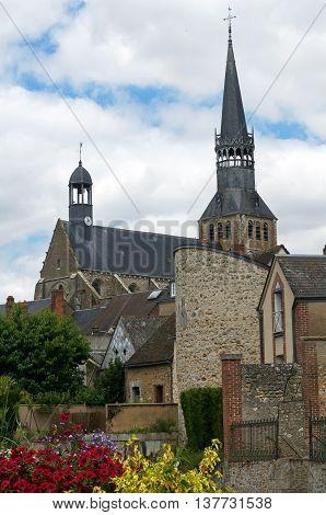 landscape with a church, vegetation and house Bonneval, Eure et Loire, France