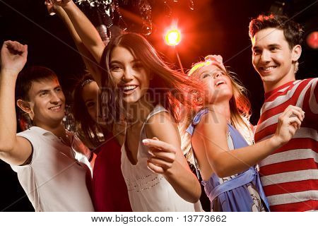 Beautiful girl making gesture meaning to join her dancing friends at party