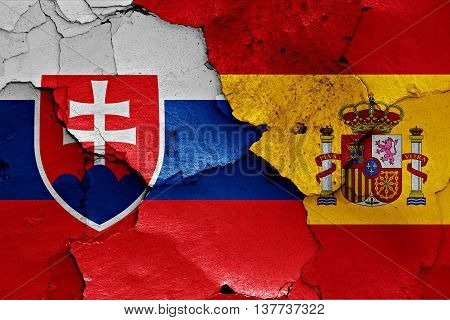 Flags Of Slovakia And Spain Painted On Cracked Wall