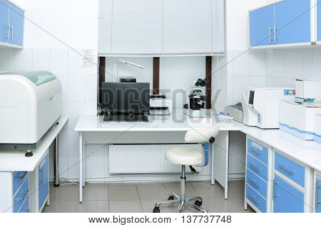 Laboratory room with medical equipment to conduct medical tests and chemical analysis