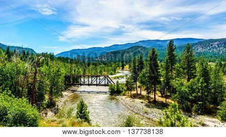 Truss Bridge over the Nicola River as it flows along Highway 8 from the town of Merritt to the Fraser River at the town of Spences Bridge in British Columbia, Canada