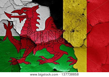 Flags Of Wales And Belgium Painted On Cracked Wall