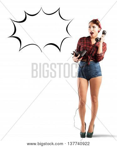 Stunned pin-up girl talk on the phone