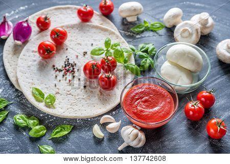 Pizza Ingredients On The Dark Wooden Background