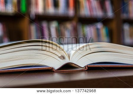 Opened Book On The Table