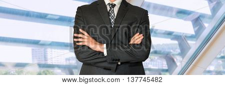 Businessman In Black Suit With Folded Hands