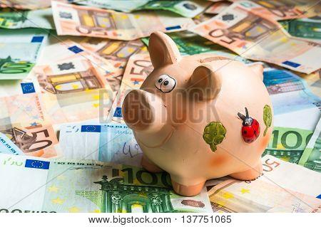 Piggy Bank In A Pile Of Euro Money