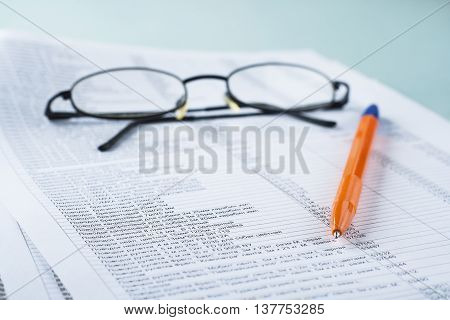 Workplace Accountant. The Documents, Pen, Paper For Notes. On Paper, The Table Is A List Of Products