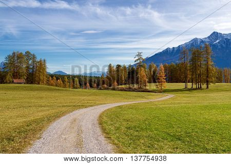 Autumn mountain scenery in the Alps with hiking trail. Mieminger plateau Austria Tyrol.