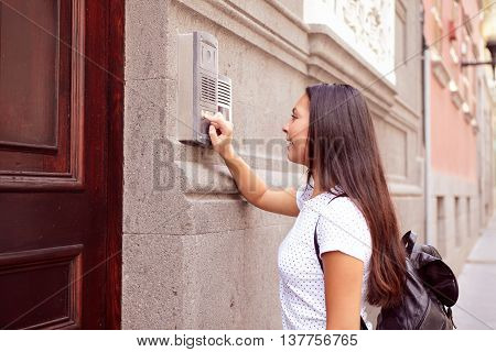 Pretty Visiting Girl Buzzing An Intercom