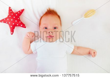 portrait of two month old redhead infant baby poster