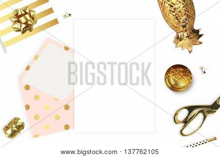 Opening envelope on white background and stationery. Flat lay. Gold accessories. Woman still. Workspace.