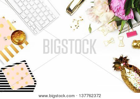 Flat lay. Flower on the table. Gold pineapple brush pattern and gold polka dots pattern. Table view. Business accessories. Mock-up background. Peonies glamour style. Open envelope. Invitation