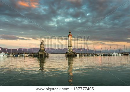 Beautiful Evening Seascape With Lighthouse In Harbor Of Lindau