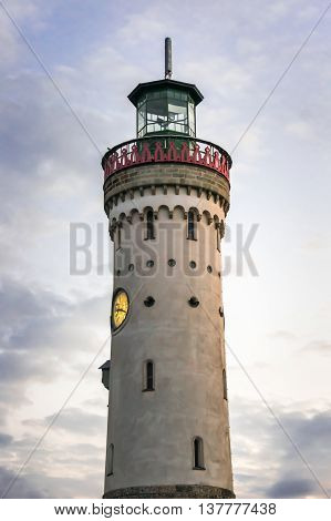 Mysterious Lighthouse At Evening In Harbor Of Lindau In Lake Con