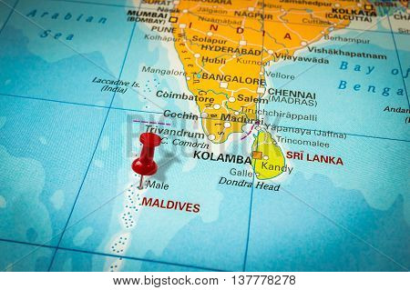Red Thumbtack In A Map, Pushpin Pointing At Maldives
