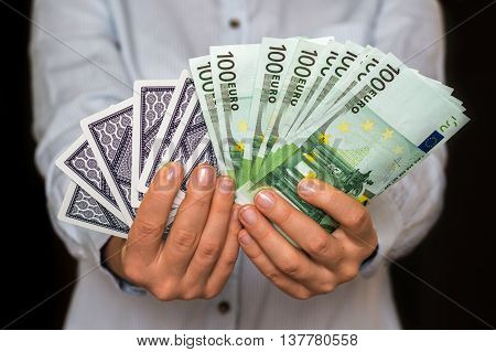 Gambler With Cards And Euro Money Banknotes
