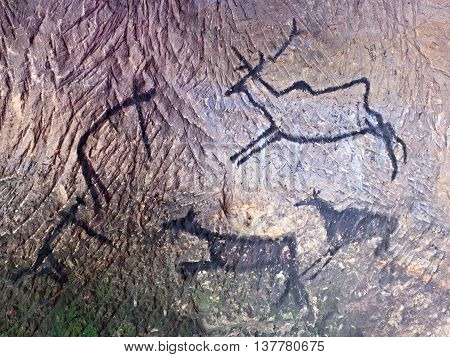 Black Carbon Paint Of Human Hunting On Sandstone Wall,