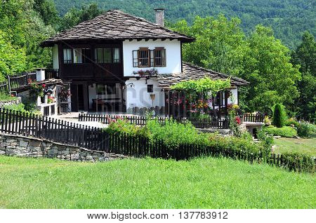 BOZHENTSI BULGARIA - JULY 2 2016: Renovated traditional house in Gabrovo province