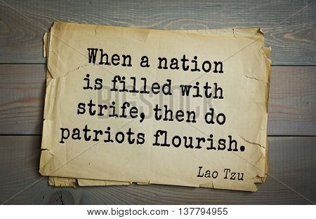 Ancient chinese philosopher Lao Tzu quote on old paper background. When a nation is filled with strife, then do patriots flourish.