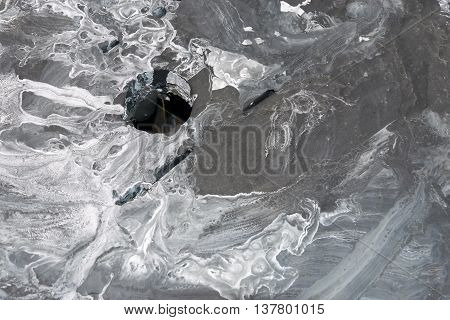 the spotty textured and indistinct abstract gray background with a hole