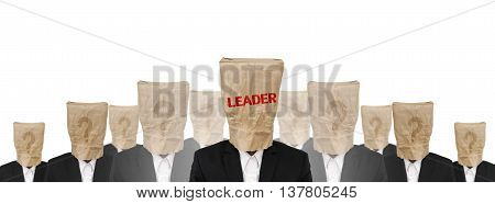 Group of businessman suit with brown paper bag on head, leadership concept