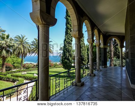 SEA OF GALILEE ISRAEL - OCTOBER 20: Church of Mount of Beatitudes marble columned gallery overlooks the landscaped park and the Sea of Galilee near Tabgha and Capernaum in Israel on October 20 2015