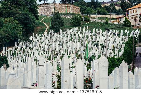 Sarajevo Bosnia and Herzegovina - August 24 2015. Graves at muslim Martyr's Memorial Cemetery in Kovaci district of Sarajevo