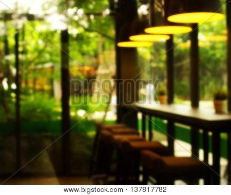 blur counter bar in green garden  interior abstract