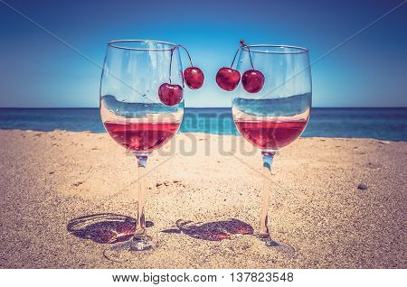 Glasses Of Wine And Cherries Near The Sea