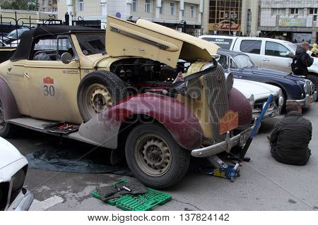 PERM RUSSIA - JUNE 29 2016: Rally of retro-cars Peking-Paris 2016 June 29 2016 in Perm Russia. Participant rally Buick Special Convertible repairs.