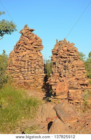 Rock cairns (man-made stone stacks) under blue skies in outback Queensland, Australia