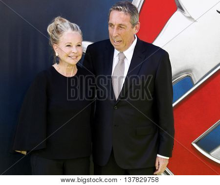 Ivan Reitman and Genevieve Robert at the World premiere of 'Ghostbusters' held at the TCL Chinese Theatre in Hollywood, USA on July 9, 2016.